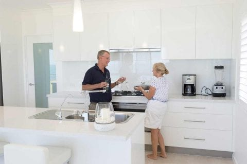couple talking in the kitchen Builders Bundaberg
