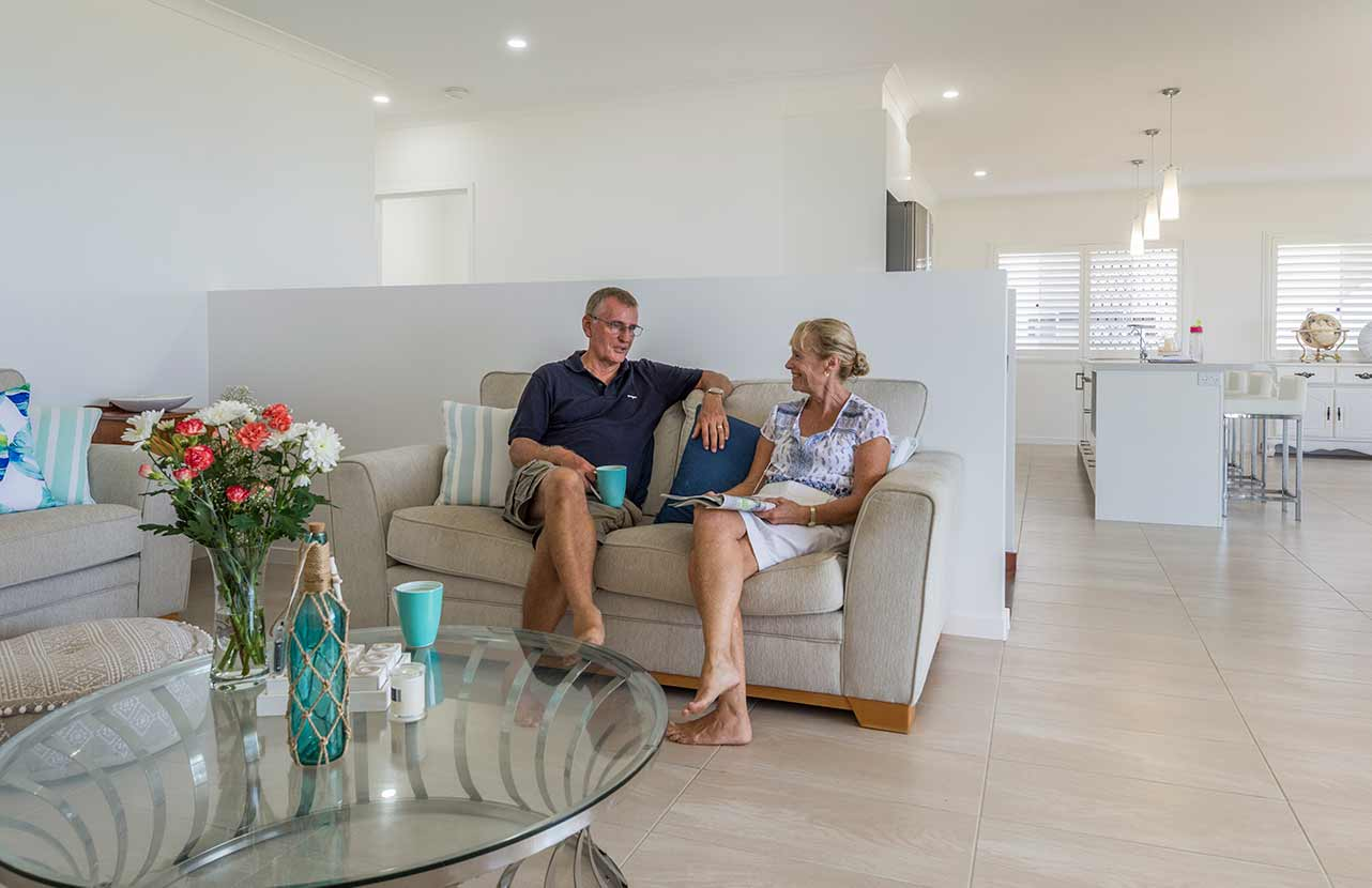 Couple sitting on the couch in their Bundaberg Home