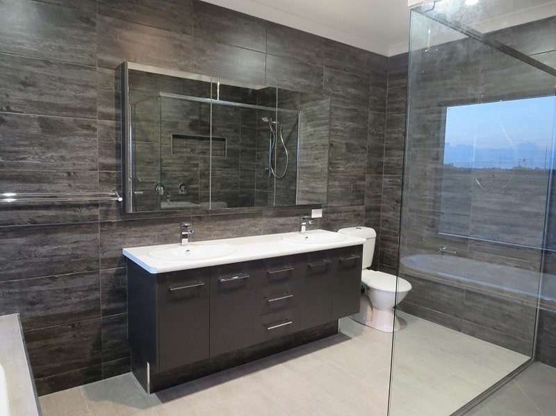 bathroom sink with brown cabinet